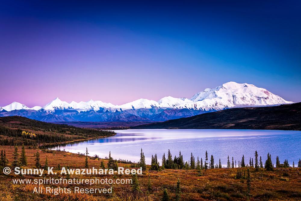 Mount Denali (McKinley) and Wonder Lake in twilight, Denali National Park & Preserve, Interior Alaska, Autumn.