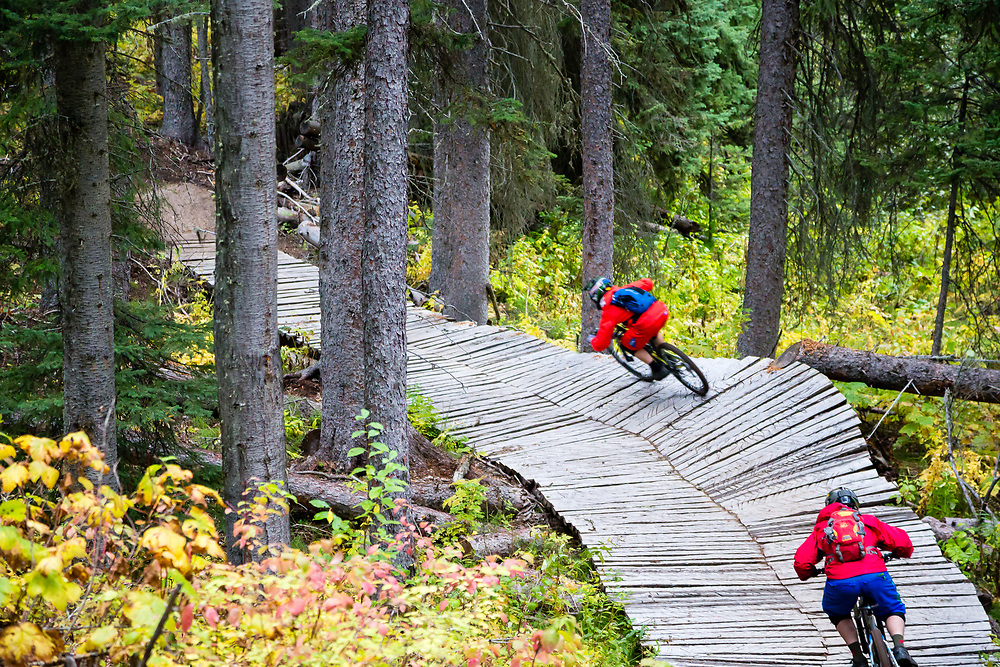 Harlan Hottenstein (Back) and Andrew Whiteford (Front) descend the Lithium single track off of Teton Pass near Wilson, Wyoming.