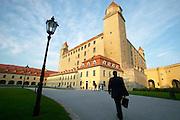 Europe, Slovakia, capitol city - Bratislava.  Business man strolls up to Pub outside Bratislava castle..
