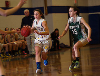 Gilford's Cassidy Bartlett charges down court ahead of Newfound's Bridget Lavin during NHIAA Division III Basketball Tuesday evening.  (Karen Bobotas/for the Laconia Daily Sun)