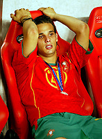 Fotball<br /> Euro 2004<br /> 04.07.2004<br /> Finale<br /> Hellas v Portugal<br /> Foto: SBI/Digitalsport<br /> NORWAY ONLY<br /> <br /> Nuno Gomes cries in the dug-out as Greece lift the cup