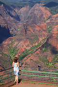 Visitor at Waimea Canyon, also called the Grand Canyon of the Pacific, Kauai, Hawaii.  (model released)