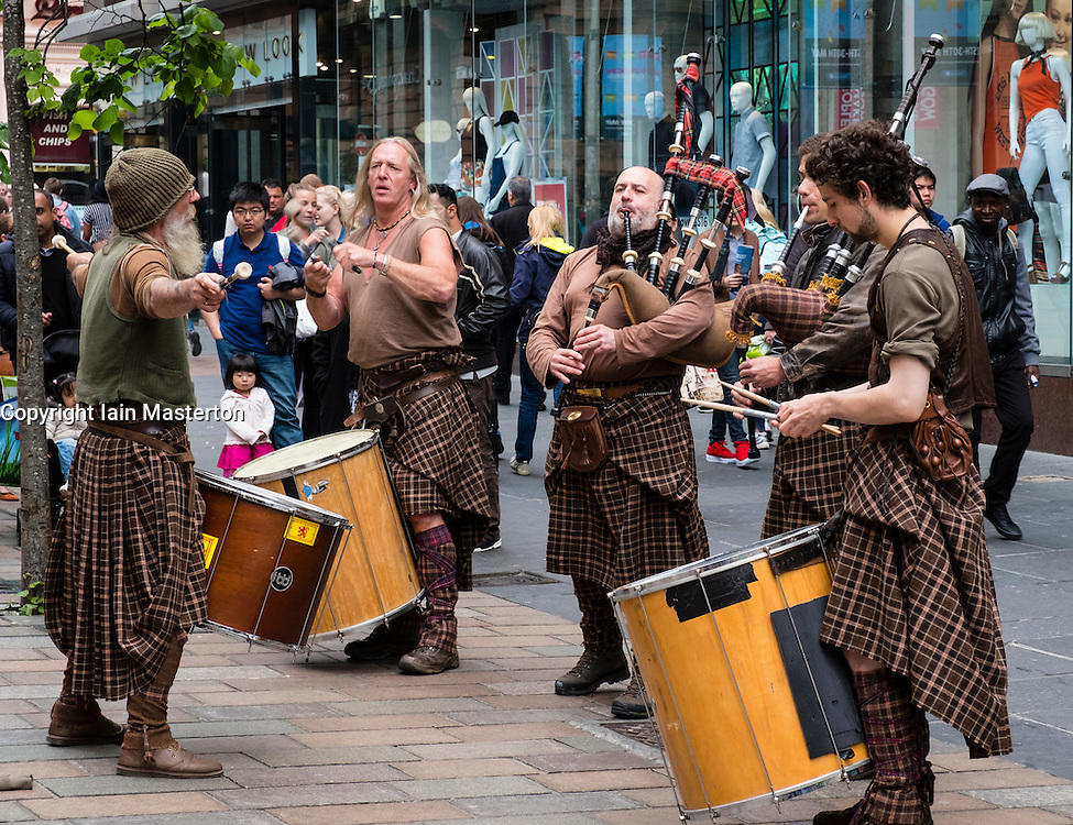 Scottish street buskers playing traditional music on Buchanan Street in Glasgow Scotland United Kingdom