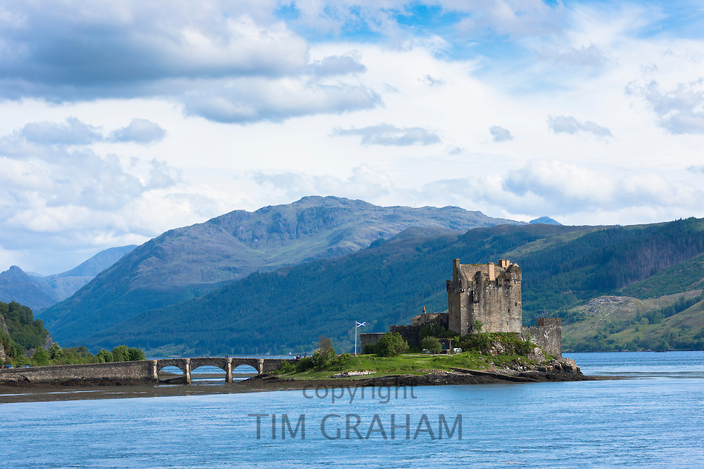 Eilean Donan Castle, a highland fortress, with Saltire Scottish flag flying in Loch Alshe at Dornie, Kyle of Lochalse in the western hIghlands of Scotland