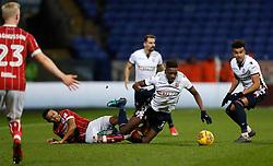 Bolton Wanderers' Sammy Ameobi battles for the ball with Bristol City's Korey Smith