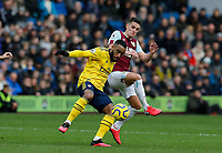 Football - 2019 / 2020 Premier League - Burnley vs. Arsenal<br /> <br /> Ashley Westwood of Burnley challenges Alexandre Lacazette of Arsenal, at Turf Moor.<br /> <br /> <br /> COLORSPORT/ALAN MARTIN