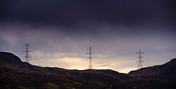 Electricity pylons cross the mountains high above Loch Arklet, Loch Lomond & The Trossachs National Park, Scotland<br /> <br /> (c) Andrew Wilson | Edinburgh Elite media