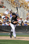 GLENDALE, AZ - MARCH 5:  Paul Konerko #14 of the Chicago White Sox bats against the Los Angeles Dodgers on March 5, 2010 at The Ballpark at Camelback Ranch in Glendale, Arizona. (Photo by Ron Vesely)