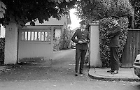 """Police outside the home of Judge Rory Conaghan who was shot dead in his Belfast, N Ireland, home.  On the same day at approximately the same time in another part of the city a Protestant magistrate, Martin McBurney, was also murdered. A  Provisional IRA statement said they had been assassinated for """"collaborating with the British war machine"""". 197409160494b..Copyright Image from Victor Patterson, 54 Dorchester Park, Belfast, UK, BT9 6RJ..Tel: +44 28 9066 1296.Mob: +44 7802 353836.Voicemail +44 20 8816 7153.Skype: victorpattersonbelfast.Email: victorpatterson@mac.com.Email: victorpatterson@ireland.com (back-up)..IMPORTANT: If you wish to use this image or any other of my images please go to www.victorpatterson.com and click on the Terms & Conditions. Then contact me by email or phone with the reference number(s) of the image(s) concerned."""