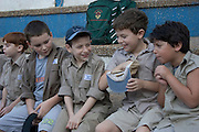 Children at the Israeli Scouts Youth Movement <br /> The Israeli Scouts were founded in 1919 The Israeli Scouts are divided into troops, which include about 40,000 members across religions and sexes. Unlike other countries boys and girls are in the same groups