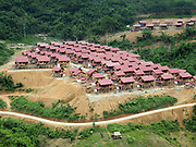 The construction of the new village of Ban Sam Sang, Phongsaly province, Lao PDR. Four Laoseng ethnic minority villages will be relocated permanently to this new village before the end of 2015 due to the construction of the Nam Ou Cascade Hydropower Project Dam 6.