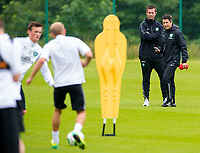 24/06/14<br /> CELTIC TRAINING<br /> LENNOXTOWN<br /> Celtic manager Ronny Deila talks tactics with his new assitant, John Collins (right)