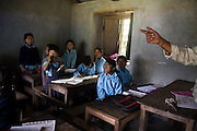 A teacher points to his students during an English lesson at the school in Chhomrong, Annapurna Himalaya, Nepal.