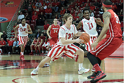 15 February 2014:  Matt Stacho heads straight to the hoop down the lane defended and eventually double teamed by Chris Blake and Anthony Fields during an NCAA Missouri Valley Conference (MVC) mens basketball game between the Bradley Braves and the Illinois State Redbirds  in Redbird Arena, Normal IL.