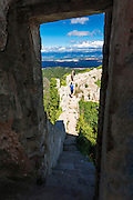 Tourists through window at St. Michael's Fort (13th Century Venetian ruins) Ugljan Island, Dalmatian Coast, Croatia