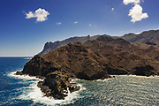 """Drone View Of the side of the island where the British government decided to build the Airport.<br /> <br /> <br /> Since discovery in 1502, until the start of commercial flights in October 2017, the sea route had been the only way to reach St Helena. At its peak more than 1,000 ships a year visited on the way to and from India and the Far East via the Cape of Good Hope. That declined after 1869 with the opening of the Suez Canal.<br /> <br /> The age of the airplane bypassed St. Helena because it offered no flat land for a runway and was consistently buffeted by treacherous winds sweeping off the water. But in the hope of stoking the tourist trade, the British spent almost $400 million to fill in a valley by 2014 with some 800 million pounds of dirt and rock to solve the runway problem and build an airport. Today, only a special, stripped-down Embraer 190 jet with the best pilots in the world can stick the landing. The airport was, soon after, dubbed as the """"world's most useless airport"""" due to high winds and difficult landings."""