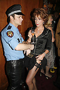 Policeman, Arron Guy, and Kathy Lette, Krug host the launch of Kathy Lette's book. ' How to Kill Your Husband' the Courthouse Hotel Great Marlborough St. London. 26 April 2006. ONE TIME USE ONLY - DO NOT ARCHIVE  © Copyright Photograph by Dafydd Jones 66 Stockwell Park Rd. London SW9 0DA Tel 020 7733 0108 www.dafjones.com