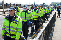 © Licensed to London News Pictures 29/05/2021. Dover, UK. A large police presence at an anti-immigration protest in Dover. Demonstrators marching through Dover in Kent today in protest against immigration and the amount of migrants crossing the English Channel in small boats. Photo credit:Grant Falvey/LNP