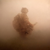 Corporal Price (Nicknamed SLICE for the machete he carries) moves through a cloud of smoke and dust caused by the explosive charge he just used to create a breach in a compound wall. An attachment of Royal Engineers( EOD specialists) and  B (Malta) Company 1st Battalion The Mercian Regiment undertake a 16 hour foot patrol to clear IED's (improvised explosive devices) around their base. The mission, which is one of the most dangerous tasks undertaken by the troops involved isolating suspected IED sites by blowing through compound walls and creating a cordon whilst the suspect site is examined and the any devices found are neutralized. The patrol left the base under the cover of darkness and worked throughout the day in searing temperatures reaching 55 C occasionally exchanging fire with the enemy. At nightfall the patrol retuned to base.  Nahr-e Saraj, Helmand Province, Afghanistan, 20th of August 2010.