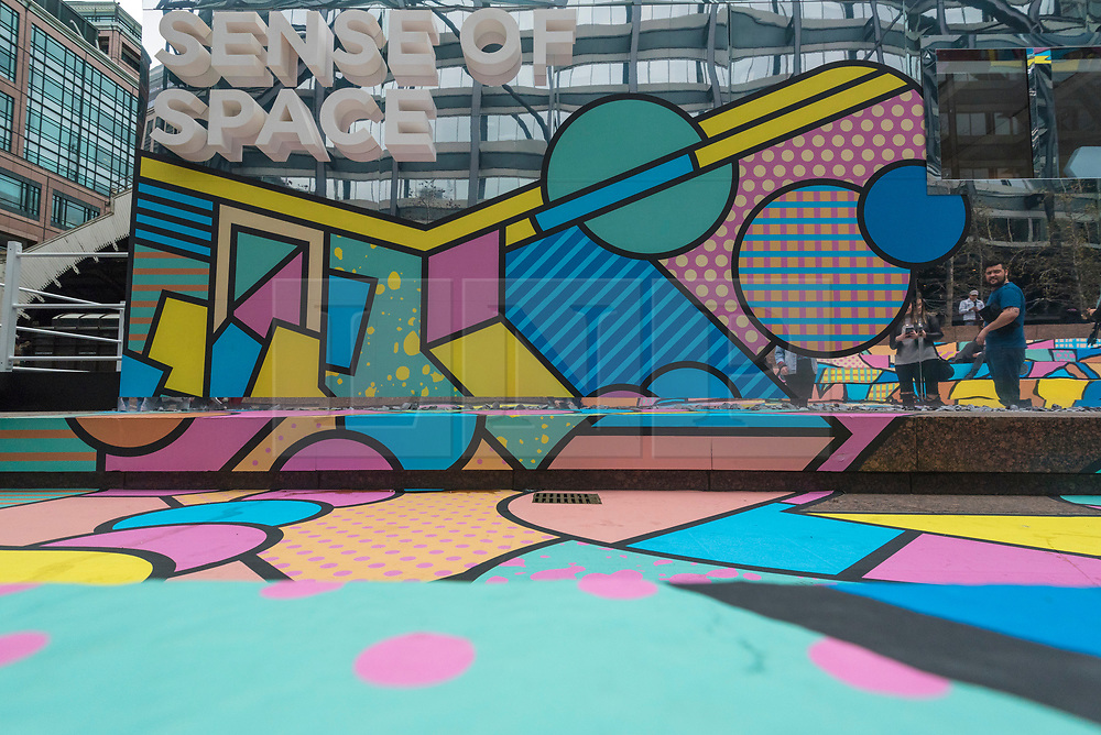 "© Licensed to London News Pictures. 07/04/2018. LONDON, UK.  The colourful entrance mural by graphic designer artist Supermundane outside ""Sense of Space"", an art pop-up which opened to the public in Broadgate.  Comprising four rooms to challenge the visitor's sensory perceptions through art, the installation is open until 18 May.  Photo credit: Stephen Chung/LNP"
