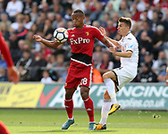Andre Carrillo of Watford (l) is challenged by Tom Carroll of Swansea City . Premier league match, Swansea city v Watford at the Liberty Stadium in Swansea, South Wales on Saturday 23rd September 2017.<br /> pic by  Andrew Orchard, Andrew Orchard sports photography.