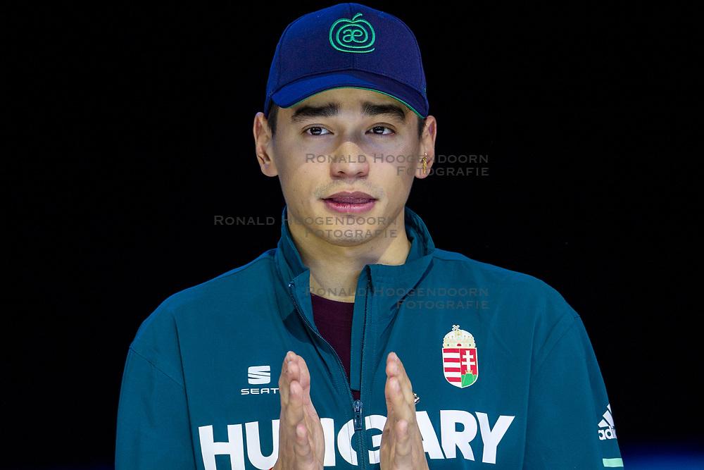 12-01-2019 NED: ISU European Short Track Championships 2019 day 2, Dordrecht<br /> Shaolin Sandor Liu of Hungary pose in the Men's 1500m medal ceremony during the ISU European Short Track Speed Skating Championships