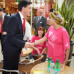 © Licensed to London News Pictures.  19/07/2014. Milton Keynes, UK. Labour leader ED MILIBAND speaks to Sarah Hamdi, a volunteer at the MK International Festival, during a visit to the Centre:MK shopping centre in Milton Keynes. Photo credit: Cliff Hide/LNP