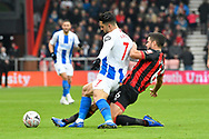 Beram Kayal (7) of Brighton and Hove Albion is tackled by Andrew Surman (6) of AFC Bournemouth during the The FA Cup 3rd round match between Bournemouth and Brighton and Hove Albion at the Vitality Stadium, Bournemouth, England on 5 January 2019.