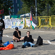 Activists are sleeping at night outside the approach road, the East Gate to block the entrance to th