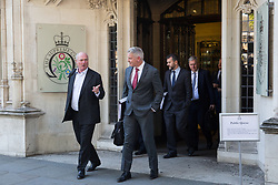 London, UK. 18 September, 2019. Sir James Eadie QC (l), acting for the Government, leaves the Supreme Court at the end of the second day of a hearing to consider whether the Prime Minister broke the law by suspending Parliament in advance of Brexit Day. The purpose of the hearing is to adjudicate as to which of two court rulings should prevail, either a ruling by the High Court that the suspension of Parliament is a political decision to be made by the Prime Minister or a ruling by the Scottish courts that the Prime Minister's actions in proroguing Parliament were unlawful. Credit: Mark Kerrison/Alamy Live News