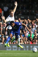 Kevin McDonald of Fulham (L) tackles Nathaniel Mendez-Laing of Cardiff City (R).EFL Skybet football league championship match, Fulham v Cardiff city at Craven Cottage in London on Saturday 9th September 2017.<br /> pic by Steffan Bowen, Andrew Orchard sports photography.