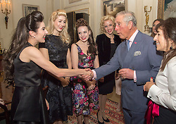 The Prince of Wales meets members of The Tootsie Rollers, as he hosts a reception to celebrate the 20th anniversary of the Walk the Walk charity at Clarence House, London.