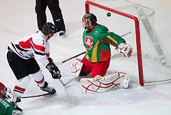 David Lindner of Austria scores vs goalkeeper of Lithuania Mantas Armalis  during the ice hockey match between National teams of Lithuania (LTU) and Austria (AUT) at 2011 IIHF World U20 Championship Division I - Group B, on December 12, 2010 in Ice skating Arena, Bled, Slovenia.  (Photo By Vid Ponikvar / Sportida.com)
