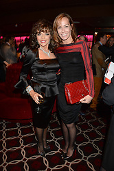Left to right, JOAN COLLINS and TARA PALMER-TOMKINSON at a party to celebrate the publication of 'Passion for Life' by Joan Collins held at No41 The Westbury Hotel, Mayfair, London on21st October 2013.