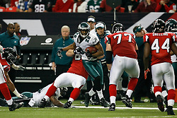 Philadelphia Eagles safety Sean Jones #26 carries the ball after an interception during the NFL game between the Philadelphia Eagles and the Atlanta Falcons on December 6th 2009. The Eagles won 34-7 at The Georgia Dome in Atlanta, Georgia. (Photo By Brian Garfinkel)