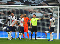 Football - 2020 /2021 Premier League - Tottenham Hotspur vs Newcastle United<br /> <br /> Referee, Peter Bankes tells players to walk away before the controversial goal from the penalty is taken in injury time, at the Tottenham Hotspur Stadium.<br /> <br /> COLORSPORT/ANDREW COWIE