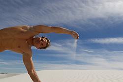 Shirtless man in White Sands, NM