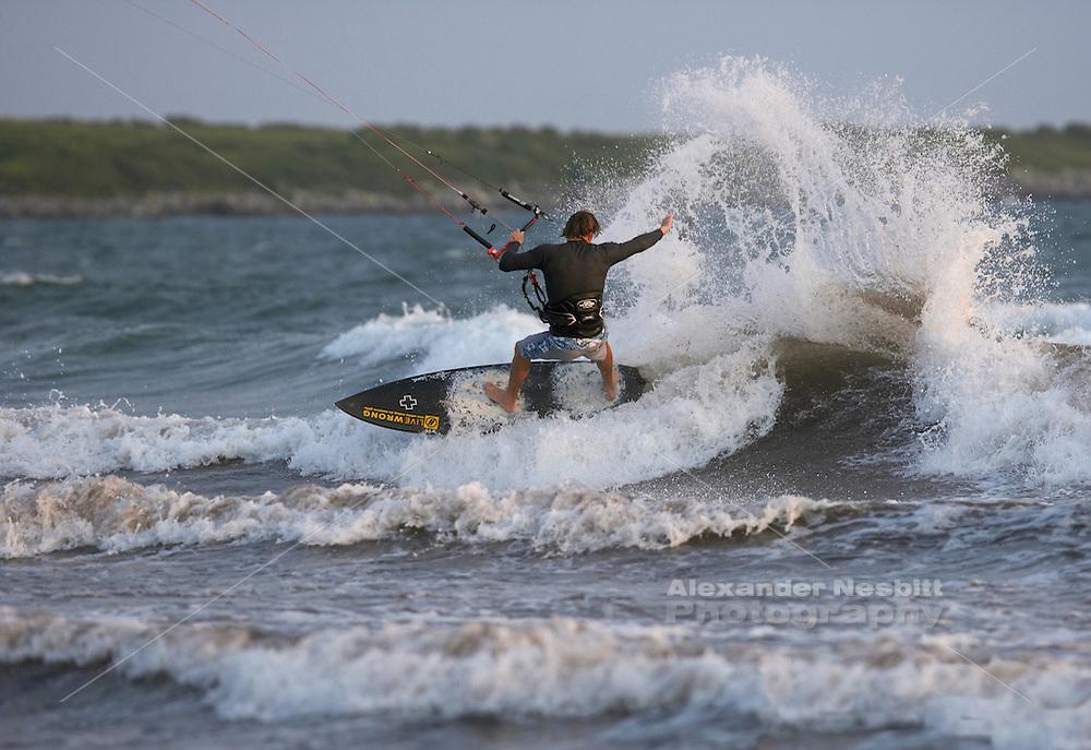 Sachuest Beach, Middletown, RI - Christian Schlebach slams a heel side on strapless carbon surfboard