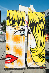 Painting on former concrete sections of the Berlin Wall in Berlin Germany