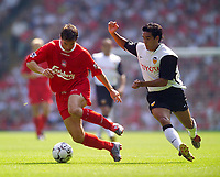 Photo. Jed Wee<br /> Liverpool v Valencia, Pre-season Friendly, Anfield, Liverpool. 09/08/2003.<br /> Liverpool's Harry Kewell (L) tries to outfox Valencia's Vicente Rodriquez.