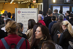 © licensed to London News Pictures. London, UK 28/10/2013. Commuters queueing for Piccadilly line service of the London Underground whilst severe delays affecting the service due to obstacles on tracks caused by St Jude's Day Storm on Monday, 28 October 2013. Photo credit: Tolga Akmen/LNP