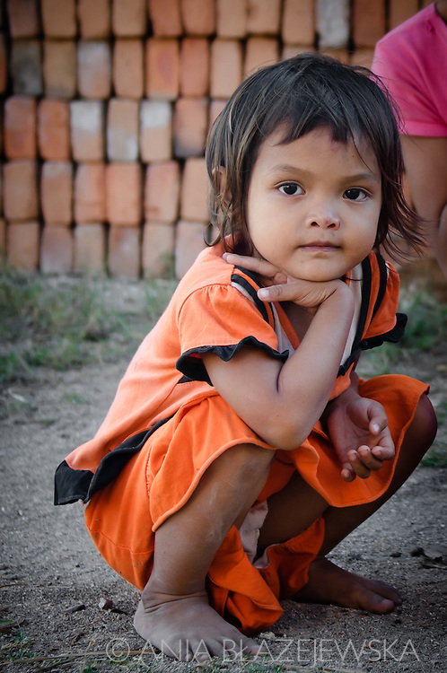 Indonesia, Lombok. A little girl from Kuta looking directly at a camera.