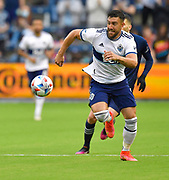May 16, 2021 - Kansas City, KS, United States:   Vancouver Whitecaps forward Lucas Cavallini (9) races the ball downfield. Sporting KC beat the Vancouver Whitecaps FC 3-0 in a Major League Soccer game. <br /> Photo by Tim Vizer/Polaris