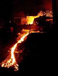 © Licensed to London News Pictures. 29/10/13.Teesside. Tata Steel says it plans to cut up to 500 jobs in Scunthorpe, Workington and Teesside because of weak demand in the construction industry FILE PICTURE of the Steel works on Teesside. Molten metal is seen in the blast furnace. Photo credit should read Ian Forsyth/LNP