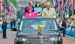Embargoed to 0001 Wednesday December 28 File photo dated 12/06/16 of Queen Elizabeth II and the Duke of Edinburgh with the Duke and Duchess of Cambridge and Prince Harry making their way down The Mall in an open topped Range Rovers, during the Patron's Lunch in central London in honour of the Queen's 90th birthday.