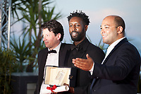 Director Ladj Ly, winner of the Jury Prize award for the film Les Miserables with producers Christophe Barral and Toufik Ayadi at the Palme D'Or Award photo call at the 72nd Cannes Film Festival, Saturday 25th May 2019, Cannes, France. Photo credit: Doreen Kennedy