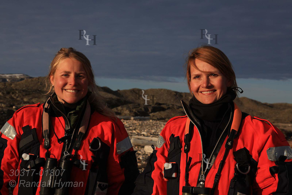 Police officer Cecilie Sørensen and naturalist Ragnhild Røsseland of governor's office (Sysselmannen) patrol western coast of Spitsbergen island near Kongsfjorden; Svalbard, Norway.