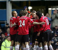 Photo: Lee Earle.<br /> Portsmouth v Manchester United. The Barclays Premiership. 11/02/2006. United players celebrate after Ruud van Nistelrooy scored their opening goal.