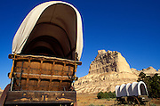 Conestoga wagons under Eagle Rock on the Oregon Trail, Scotts Bluff National Monument, Nebraska USA