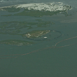 A double layer of oil containment boom is laid out in an effort to protect the Breton National Wildlife Refuge off the coast of Louisiana in the Gulf of Mexico, U.S., on Saturday, May 1, 2010. The BP Plc Deepwater Horizon drilling rig oil spill is threatening the wildlife that inhabit Breton Sound including the Louisiana state bird the brown pelican. Photographer: Derick E. Hingle